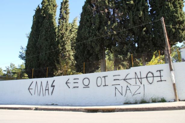 Graffiti on the wall surrounding the refugee detention centre at Corinth